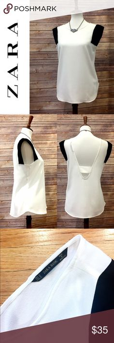 """Zara open back tank top Pretty and flowy sleeveless blouse from Zara. Contrasting black around shoulders. Open/low back. Silky poly. No condition issues, worn once. Length from shoulder is about 24"""". Armpit to armpit flat is 19.5"""". Zara Tops Tank Tops"""