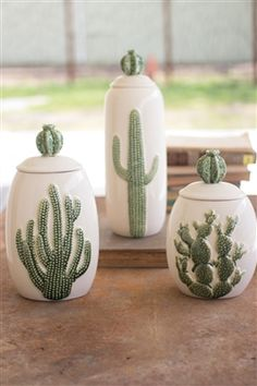 We're in love with these cactus cannisters. This set of three features a glazed ceramic stoneware vessel each with a different type of cactus adorned on the front of each container. Each lid is adorned with a cute little barrel cactus. Decoration Cactus, Decoration Table, Balcony Decoration, Canister Sets, Canisters, Home Decor Accessories, Decorative Accessories, Kitchen Accessories, Deco Boheme Chic