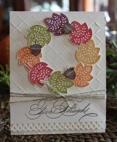 handcrafted Thanksgiving card ... wreath made from folk style leaves from the Day of Gratitude set ... luv the cheerful colors and addition of stamped acorns ... trellis embossing folder texture ... triple wrapped twine ... calligraphy style sentiment ... Stampin' Up!