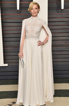 ELIZABETH BANKS in a Ralph and Russn gown with fully embellished bodice and sweeping cape, plus Tiffany & Co. jewels at the 2016 Vanity Fair Oscar After-Party