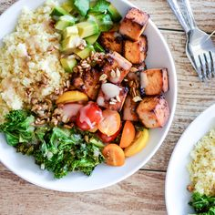 Kale and Couscous Tofu Bowls with Orange Tahini Dressing is a weeknight dinner recipe that is super hearty, filling and packs a lot of flavor!