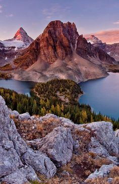 Mount Assiniboine, also known as Assiniboine Mountain, is located on the Great Divide, on the British Columbia/Alberta border. At 3,618 m(11,870 ft), it is the highest peak in the Southern Continental Ranges of the Canadian Rockies.