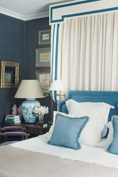 blue and white bedroom in England~ designer Paul Moschino