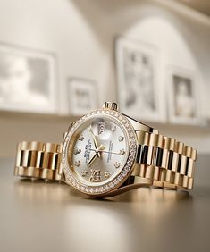 The Rolex Lady-Datejust 28 with a distinctice Sundust Dial, gold 18 ct star-shaped hour markers and hand-set diamonds.