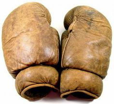 BOXING: A rare pair of antique professional boxing gloves. The vintage gloves were made by an extinct sporting goods equipment company.