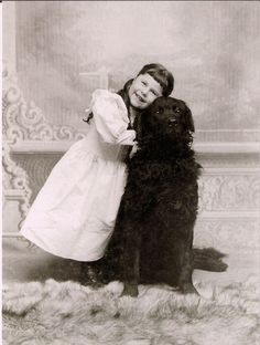 Such a heartwarmingly sweet vintage image of a youngster and her loyal, loving dog.