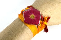 Real red rose on a recycled sari tie. $26.00, via Etsy.