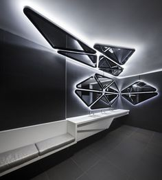 Image 17 of 20 from gallery of The Prémont Lantern / DMG architecture + Bourgeois Lechasseur Architectes. Photograph by Bourgeois Lechasseur Architectes Backlit Mirror, Futuristic Interior, Ceiling Design, Retail Design, Bathroom Interior, Interior Architecture, Building Architecture, Harley Davidson, Modern Design