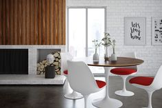 The modern Saarinen Round Dining Table adds a unique accent to your home with its fun retro look. Inspired by the work of Eero Saarinen, this table's look will be recognizable by many. Chair: http://www.inmod.com/saarinen-tulip-side-chair.html Table: http://www.inmod.com/saarinen-round-dining-table.html