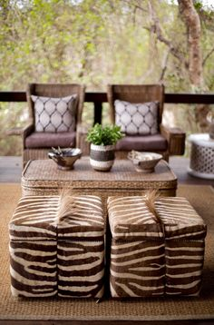 African inspired outdoor sitting area with stylish zebra skin upholstery stools African Interior Design, African Design, Ethnic Design, Design Design, African Theme, African Style, African Safari, African Prints, African Fabric