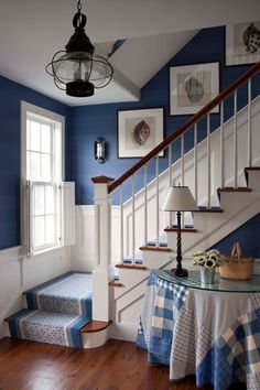 How to add coastal style to your home. Blue and white staircase evokes nautical theme.