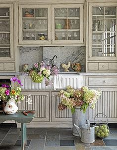 deep sink.  beadboard + glass-front cabinet doors.  flowers.