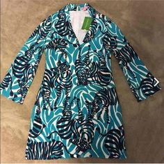 NWT In Game Small Lilly Pulitzer Dress Gorgeous Lilly Pulitzer Devina dress! I'm not sure if I want to sell yet or not. Feel free to make offers! I might be willing to t rade for anything Lilly in 00, just offer :) Lilly Pulitzer Dresses Mini
