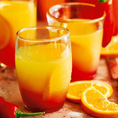 Golden tequila, orange juice and a dash of grenadine are the key ingredients in a tequila sunrise. Add a chilli twist to spice up any dinner party in our take on the traditional Mexican cocktail. | Tesco