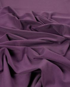 Polyester Jersey Fabric - Lupin  A medium weight polyester and spandex jersey fabric in a rich lupin purple shade. A super-slinky, heavily draping stretch fabric with a smooth texture.