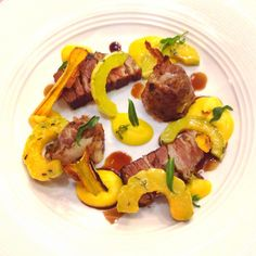 Lamb Crepinette. Crispy belly, squashes with their skins, gastrique, marigold mint @nichestlouis