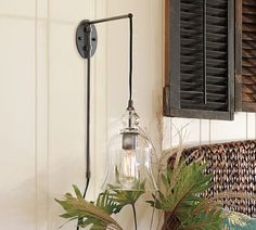 This Pottery Barn plug-in lamp is great for a balcony or bedside! I'd love to read with this night light! - $129