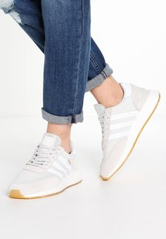adidas Originals. INIKI RUNNER - Trainers - grey one/white. Pattern:Print. Care instructions:treat with a suitable protector before wear. Sole:synthetics. Shoe tip:round. Heel type:flat. Lining:textile. detail:decorative seams. shoe fastener:laces. upper ma...
