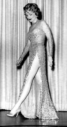 The famed Marlene Dietrich legs regain their prominence at the Hotel Sahara, in a gown slashed to the hip. The glamorous grandmother wears the creation studded with canary diamonds, in her nightclub production. Glamour Ladies, Old Hollywood Glamour, Hollywood Fashion, Golden Age Of Hollywood, Vintage Hollywood, Hollywood Style, Marlene Dietrich, Film Icon, Classic Movie Stars