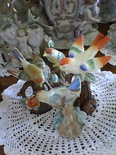 Quartet of Occupied Japan bird figurines