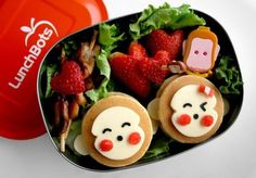 monkey bento made from flapjacks and cheese (with tomato)