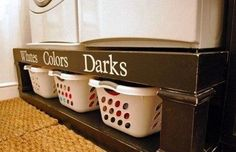 What a neat way to hide dirty laundry and avoid buying the expensive bases for the washer and dryer!