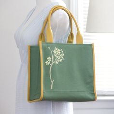 Lightweight tote bag handpainted and monogrammed handbag /document bag / carry all/ green and yellow only $54. enter coupon code FREESHIP50 for free shippping