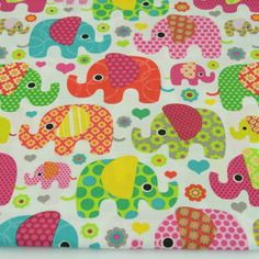 """Tissu imprimé """"éléphants multicolores"""" 100% coton fond  blanc"""