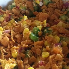 Mexican Corn Salad- Green, red, orange & yellow peppers. Birds eye frozen super sweet corn (cooked), 1/4 of an onion and about 1/4-1/2 cup of miracle whip all mixed in a bowl. Just before serving crush chili cheese fritos on top. Can be served right away or cold.