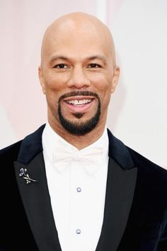 Oscars' Best-Groomed Men | Common looks dapper in a Prada tuxedo and white tie at the 2015 Oscars