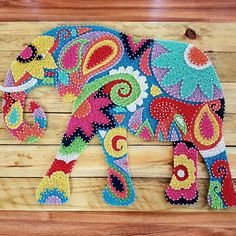 Tribal Elephant Colourful String Art Wall Art on rustic pine