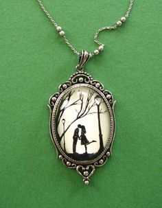 Love this.  Reminds me of Tim Burton. Autumn Kiss papercut necklace. $50.00