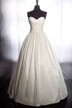 plain and simple a-line ballgown with rucheing.This pretty much the style I see in my head. Add a diy peacock belt/sash and it would be perfect