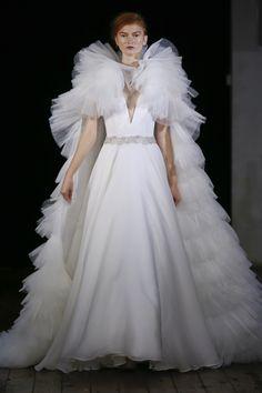 Classic, A-Line wedding dress with removable cape at Solutions Bridal Orlando.     Designer - Rita Vinieris Rivini Fall/Winter 2017