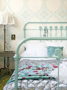 vintage bed ~~~  baby blue bed frame and beautiful wallpaper. I want a bed like this someday.