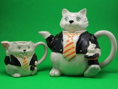 This is almost a complete tea set - a magician cat teapot and creamer designed by Mary Ann Baker and put out by Otagari. This is also a unique set