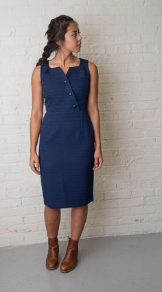 Look perfectly put together in this fitted navy dress with an elegant neckline and 3 navy stone accents; make it casual with a jean jacket and boots. 100% Polye