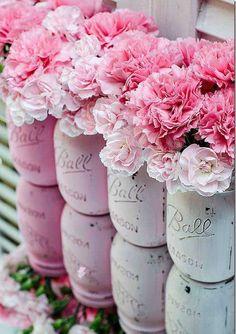 Pretty flowers in painted mason jars