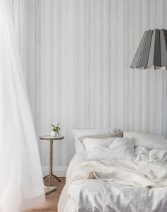 The Ultimate Guide To Wallpaper & Your Homes | Wallpaper designs that use thediagonalprovide a sense of direction which createsmovementin a room. Striped or patterned wallpaper with strong vertical lines draw the eye upwards and creates visual height to a room. Whereas hung horizontally it provides movement and a sense of direction and make narrow rooms appear wider. #walldecor #wallpaper #homedecor #white #bedroomdesign #scandi #bedroominspo #interiordesign #interiors #wallpaperdesign