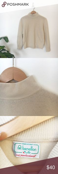 Vintage | Cream 100% Lambswool Sweater Vintage Benetton cream mock neck sweater, 100% lambswool, made in Italy Measurements: Sleeve- 22 inches Across the chest- 19 inches Shoulder to hem- 22 inches Shoulder to shoulder- 16 inches vintage Sweaters Cowl & Turtlenecks