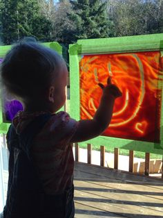 Mess-free finger painting!! My 17 month old loves these! So easy! Put finger paint into a freezer ziplock bag (for the extra durability), and tape them to a window (we used our back door).
