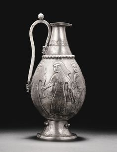 A RARE AND IMPORTANT POST-SASANIAN OR EARLY ISLAMIC SILVER EWER, PERSIA, 8TH CENTURY