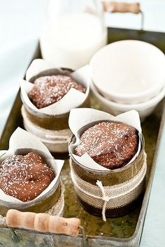 Simply Good Chocolate Cake baked in individual tin cans wrapped with string (gf)