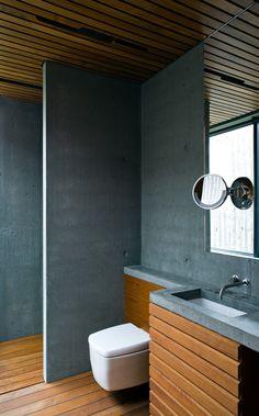 Árborg House Bathroom with Blue-Grey Concrete and Warm Teak Wood