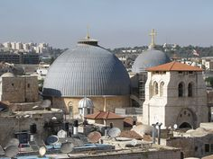 The Church of the Holy Sepulcher has been destroyed and rebuild several times through the centuries. The church we see today was constructed by the Crusaders.  The small grey dome covers the rock of Calvary, and the large dome covers the site of Jesus' burial and resurrection.