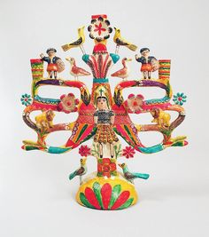 This candelero from Matamoros de Izucar, Mexico, which would have been used to decorate an altar, features brightly painted ceramic figures, birds, lions, and flowers. It was purchased by the Hearst Museum in 1958 from the Museum National de Artes e Industrias Populares. PAHMA 3-15747.