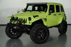 2014 Jeep Wrangler Unlimited with Kevlar Liner Finish in Lamborghini Verde Ithaca: Front-Left View