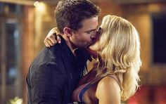 """Arrow -- """"Next of Kin"""" -- Image --Pictured (L-R): Stephen Amell as Oliver Queen/The Green Arrow and Emily Bett Rickards as Felicity Smoak -- Photo: Jack Rowand/The CW -- © 2017 The CW Network, LLC. All Rights Reserved. Arrow Felicity, Oliver Queen Arrow, Oliver Queen Felicity Smoak, Oliver And Felicity Kiss, Emily Bett Rickards, Team Arrow, Arrow Tv, Arrow Cast, Arrow Season 6"""