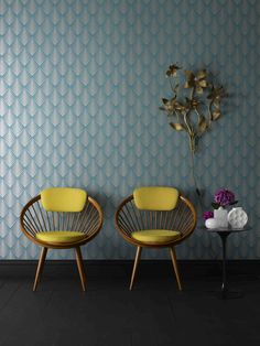 A pair of mid-century chairs in front of statement wallpaper. A Seventies inspired living room. More decorating ideas at www.redonline.co.uk