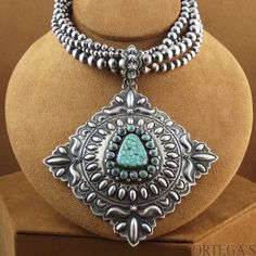 ~ This amazing pendant on sterling silver Navajo pearls  is spectacular! The center stone Is high-grade Kingman turquoise...crafted by Navajo artist Darryl Bencenti
